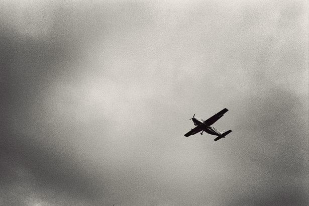 An old propeller plane seen from the ground in South Africa.