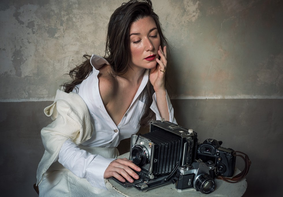 Self Portrait of photographer Jamie Beck in her home in Provence with her cameras in a photography gift guide for the holidays.